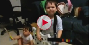 Watch this Hilarious video of 2 year old rocking out on Guitar Hero.