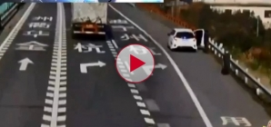 Woman get hit by a Runaway Tyre on the hard shoulder of motorway in China.