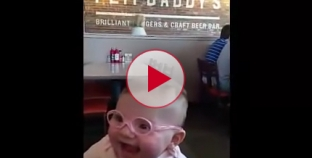 Baby sees clearly for first time with new glasses. This will melt your heart.
